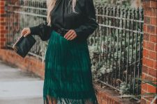 a special occasion outfit with a black blouse, an emerald fringe midi skirt, leopard shoes and a black clutch