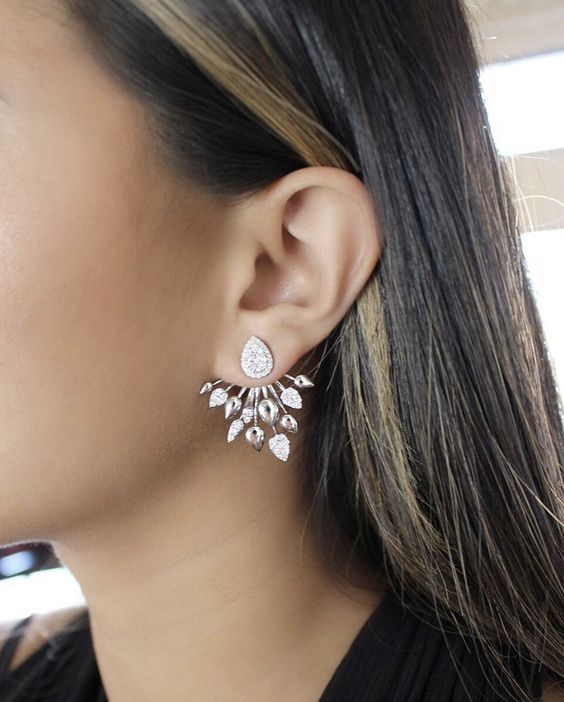 a statement ear jacket with a drop shaped vintage stud and spiky detailing with crystals and without