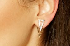 a stylish and shiny geometric jacket earring – a crystal triangle and a gold one for accenting you look in a modern way