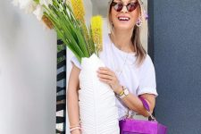 a summer look with a white tee, printed pants, a purple leather and suede bag and heart-shaped sunglasses