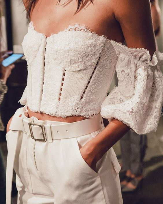 a super romantic outfit with a lace off the shoulder crop top with puff sleeves, high waisted pants