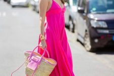 a very special outfit for some occasion done with a hot pink spaghetti strap maxi dress, hot pink sandals and a raffia bag just wows