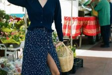 a vintage look with a navy cardigan, a printed navy midi skirt, white espadrilles and a basket bag