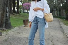 a white oversized shirt, blue jeans, black fur mules and a basket bag for a summer to fall transition