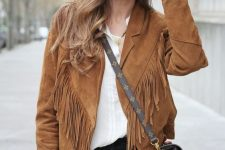 a white shirt, black jeans and a rust-colored fringe leather jacket plus a crossbody bag for fall