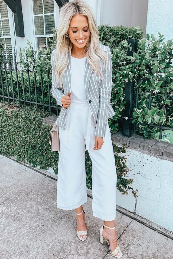 a white tee, white culottes, neutral block heels, a pink bag and a striped gray and white blazer