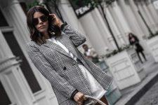 a white tee, white denim shorts, a grey plaid oversized blazer and a woven bag