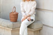 a white top, white pants, brown block heels and a basket bag for a minimal fall look