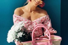 an off the shoulder pink floral crop top, polka dot black and white pants and a pink straw bag