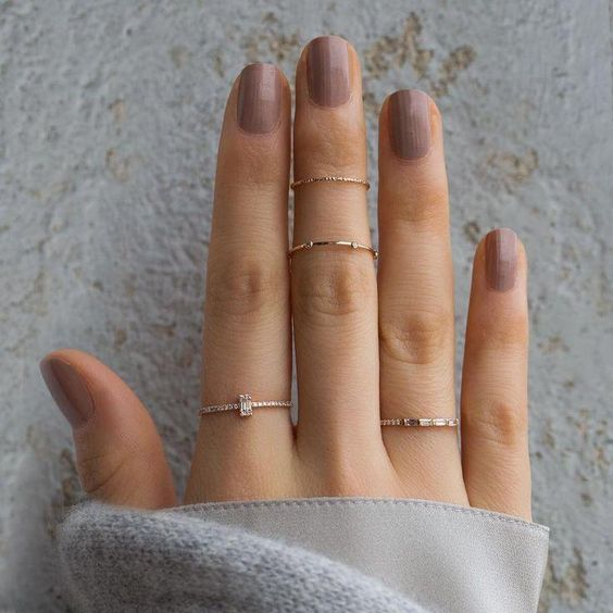 delicate gold and rhinestone rings and two intricate gold midi rings for beautiful accessorizing