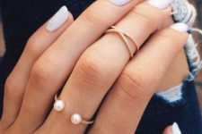 gorgeous stacked rings – a rhinestone and pearl one and a rhinestone midi ring look chic together