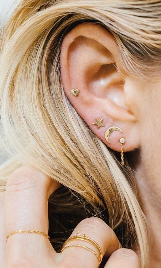 stacked lobe piercings and a helix one with mix and match gold stud earrings