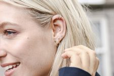 trendy mix and match ear piering idea with hoops