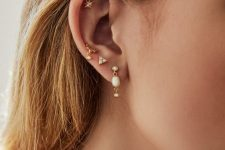 stacked lobe piercings with gorgeous gold and pearl earrings and a star stuf for the flat piercing