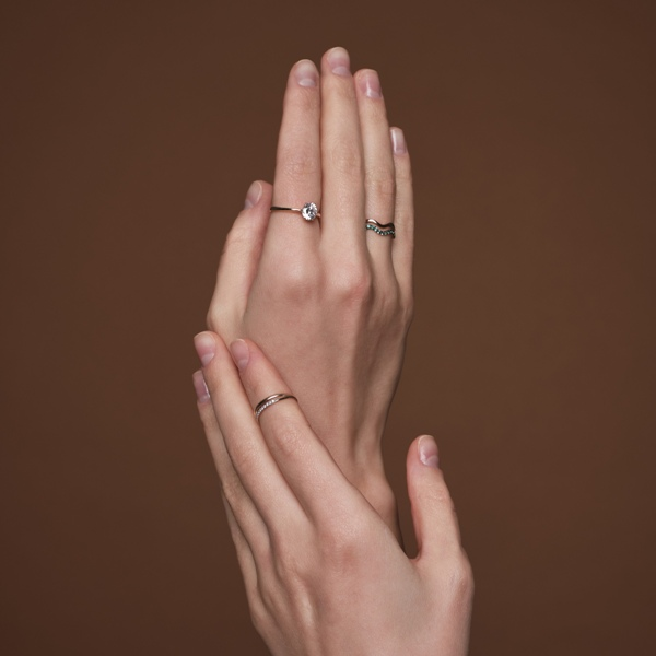two midi rings - one with emeralds and the second with diamonds are lovely accessories to rock