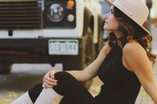 02 a black halter neckline top and skinnies, a tan hat and slouchy boots for the fall