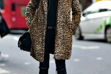 02 a black look with ripped jeans, a turtleneck, a leopard print coat, black heels and a bag