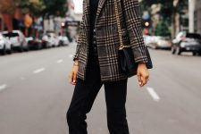 02 a black tee, black high waisted jeans, a plaid fitting blazer, tan shoes and a black bag