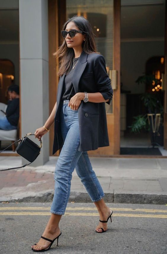 a black tee, blue cropped jeans, strappy minimal heels, a black fitting blazer and a black bag