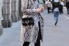 05 a neutral top, black skinnies, black booties, a snake print trench and a black crossbody bag