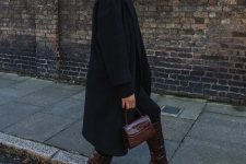 05 a total black look with a sweater, jeans, coat, burgundy reptile print boots and a bag