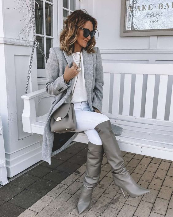 a neutral fall look with a white top, white skinnies, a grey coat, grey slouchy boots and a bag