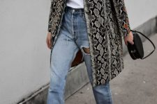 06 a white tee, blue jeans, black square toe boots, a snake print trench and a black bag