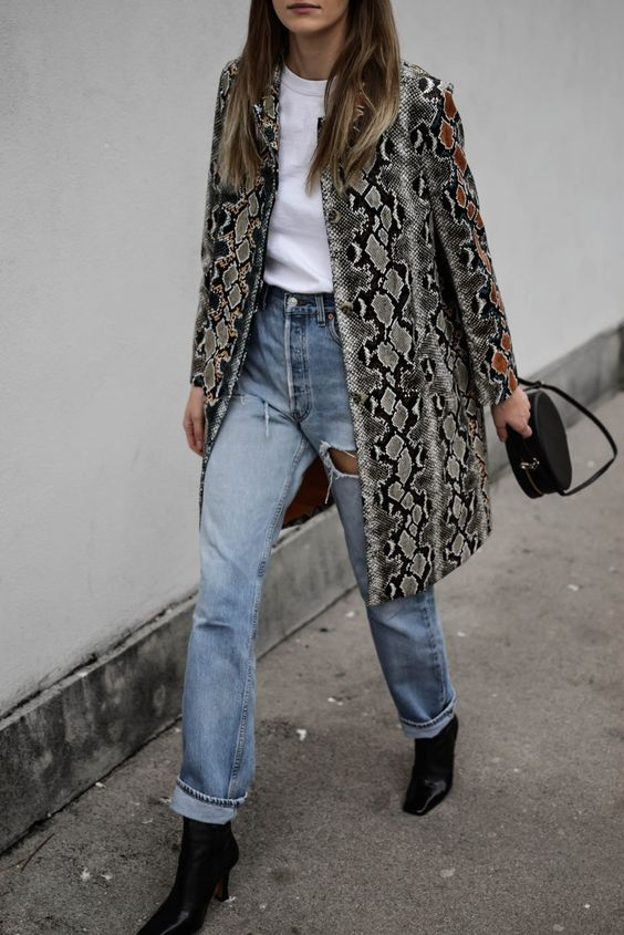 a white tee, blue jeans, black square toe boots, a snake print trench and a black bag