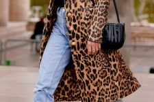 07 a trendy look with a black turtleneck, blue jeans, black combat boots and a leopard print coat