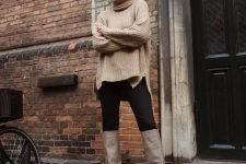 07 an oversized tan sweater, black skinnies and grey slouchy boots for a fall or winter look