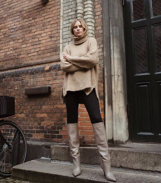 an oversized tan sweater, black skinnies and grey slouchy boots for a fall or winter look