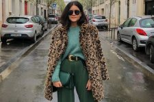 08 a stylish outfit with a green sweater, green pants, white trainers and a leopard print coat
