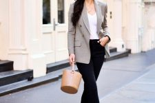 08 a white top, black raw hem skinnies, a grey plaid fitting blazer, black heels and a tan bucket bag