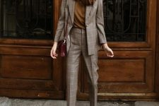 09 a grey plaid pantsuit with a mustard tee, a fitting blazer and trainers in two tones