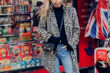 09 a statement look with a black turtleneck, blue jeans, red booties, an animal print coat and a black bag