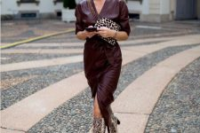 10 a burgundy leather midi wrap dress, snake print slouchy boots and a leopard print bag