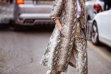 10 a snake print trench paired with snake print pants, a white tee and white heels for a wow effect