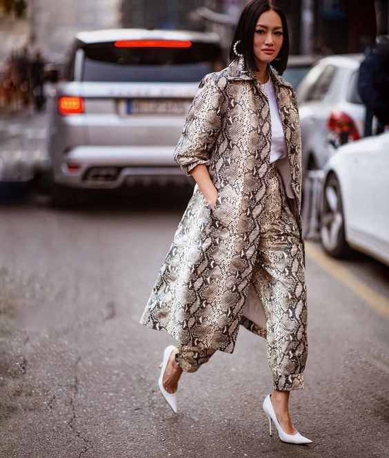 a snake print trench paired with snake print pants, a white tee and white heels for a wow effect