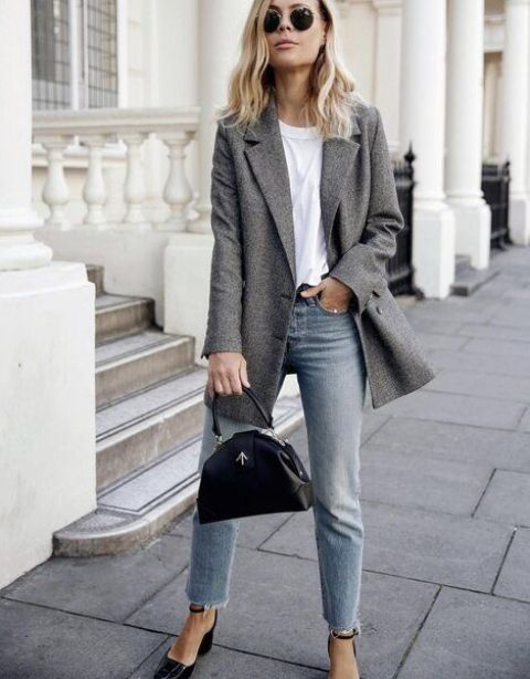 a white t shirt, blue jeans, black reptile skin heels, a grey semi fitting blazer and a catchy black bag