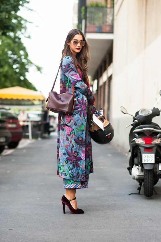 a bright floral coat, a purple bag and purple velvet shoes for a bold fall look