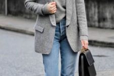 11 a grey cashmere top, blue jeans, black lacquer booties, a grey semi-fitting blazer and a black bag