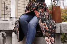 12 a chic outfit with a floral moody coat, blue skinnies, black bow mules and a logo belt