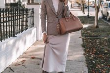 13 a stylish fall outfit with a white turtleneck, a slip skirt, a plaid blazer, grey slouchy boots and a camel bag