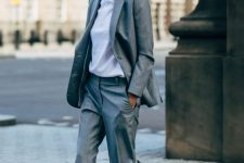 14 a comfortable grey pantsuit with an oversized blazer, a white tee and cool trainers for a casual work look