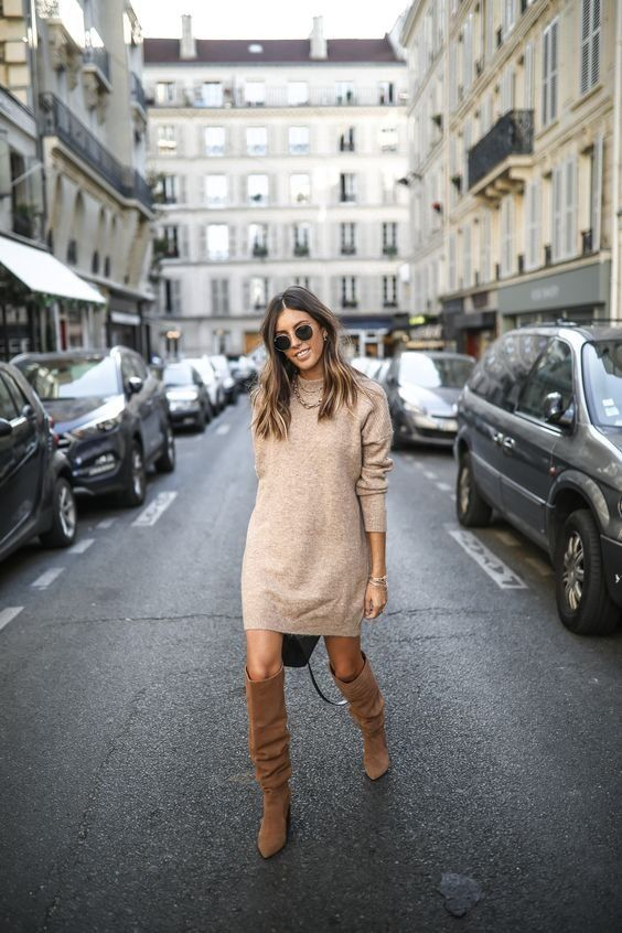 a tan mini sweater dress, brown slouchy boots, layered necklaces for a casual fall look