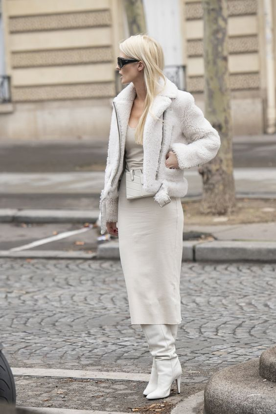 a total white look with a sheath midi dress, white slouchy boots, a faux fur coat and a mini bag for work