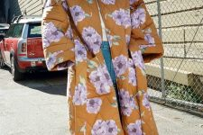 15 a white tee, blue jeans, mustard shoes and a rust-colored floral coat for a bright look