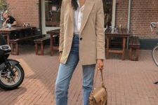 16 a white shirt, a tan oversized blazer, blue cropped jeans, white sneakers and a tan bag