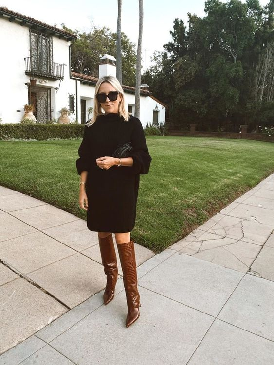 an oversized black sweater dress, brown reptile print slouchy boots, a black bag for the fall or winter