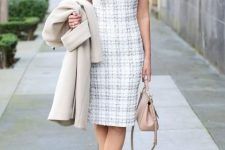 With beige coat, pale pink bag and beige pumps